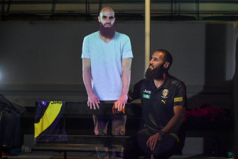 Bachar Houli watches his hologram exhibit at the soon-to-be-reopened Australian Sports Museum.