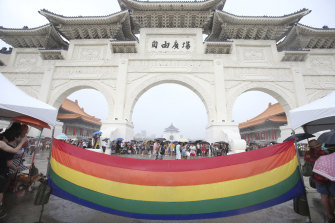 A rainbow flag at a pride march in Taiwan last month, the only place in Asia to legally recognise same-sex marriage.