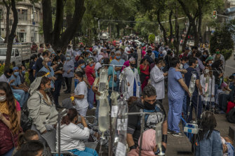 Medical staff and patients gathered outside Alvaro Obregon Hospital in Mexico City during the earthquake.