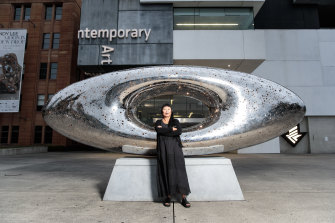 Lindy Lee with her work Secret World of a Starlight Ember, which is installed in the forecourt of the MCA.