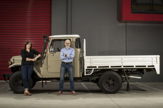 Emma Sutcliffe and EVolution Australia founder Russ Shepherd with a client's 1979 Toyota landcruiser. They have been set the unique challenge of giving it a 500km battery range.