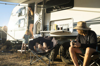 Simon and Liz Bailey with their sons in Katherine, NT. The campsite where they had planned to stay was already full at 10am in the morning, so they wild camped nearby.