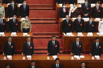 Chinese President Xi Jinping, centre, and other Chinese leaders stand during the opening session of China's National People's Congress at the Great Hall of the People in Beijing on Friday.