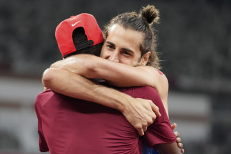 Barshim and Tamberi embrace after winning gold.