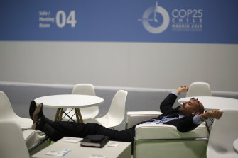 Exhausted: a delegate takes a break during the UN climate talks in Madrid.