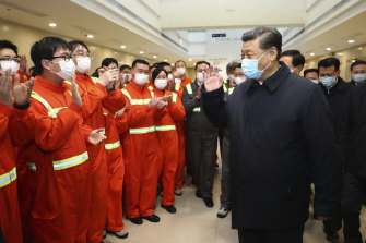 President Xi Jinping visits the Ningbo-Zhoushan Port in eastern China. Both the government and central bank are moving furiously to refloat the economy.