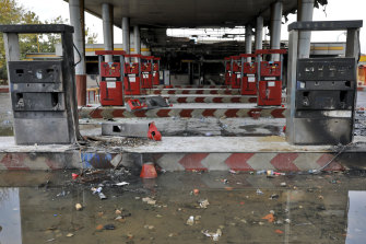 Rainwater pools at a gas station attacked during protests over government-set gasoline prices in Tehran, Iran.