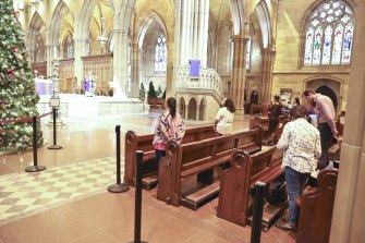 Worshippers keep their distance at St Mary's Cathederal on Wednesday.