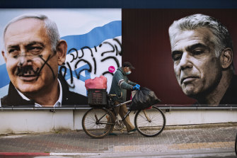 A campaign billboard for the Likud party shows a portrait of its leader Prime Minister Benjamin Netanyahu, left, and opposition leader Yair Lapid.