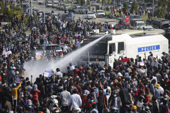 Police spray water cannon on a crowd in Nay Pyi Taw on February 8.