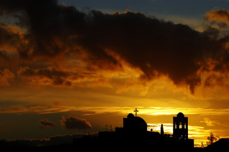 The sun sets behind a Christian Orthodox Church in Anthoupoli a suburb of the capital Nicosia, Cyprus.