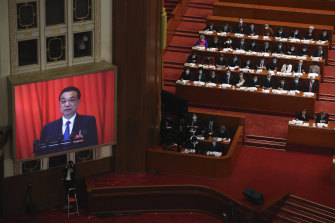 Chinese Premier Li Keqiang delivers the government work report during the opening session of China's National People's Congress.