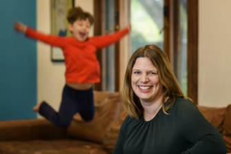 Kate Ellis, with son Sam, five, at home in Adelaide, hopes her book will shine a light on the treatment of women in politics and empower young women considering it as a career.
