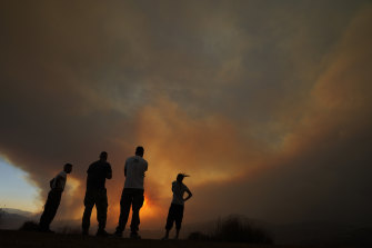 Residents of villages watch a fire in the Larnaca mountain region of Cyprus on Saturday.