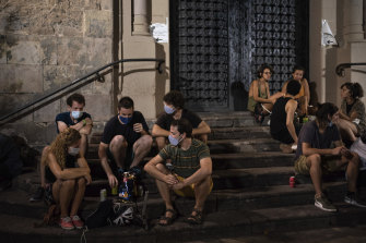 Barcelona's bars and clubs have been restricted, but young people are gathering in the streets instead.