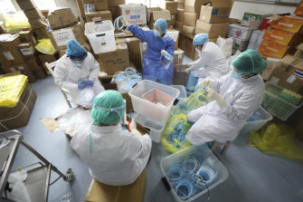 Nurses assemble plastic face shields at a hospital designated for the coronavirus patients in Wuhan.