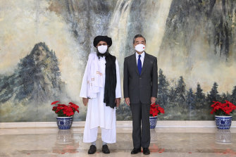 Taliban co-founder Abdul Ghani Baradar, left, and Chinese Foreign Minister Wang Yi in Tianjin, China, on July 28.