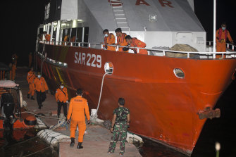An Indonesian search and rescue crew launches from Benoa harbor in Bali.