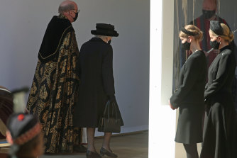 The Dean of Windsor, the Queen, Lady Louise Windsor and the Countess of Wessex follow the procession at the Galilee Porch at St George's Chapel during the funeral of Prince Philip.