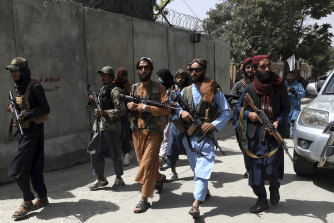 Taliban fighters patrol in Kabul on Wednesday.