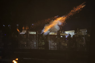 Riot police fire tear gas during clashes with students at the Chinese University of Hong Kong.