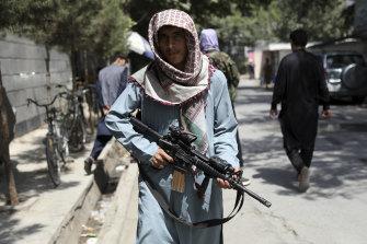 A Taliban fighter at a checkpoint in the Wazir Akbar Khan neighbourhood of Kabul on Sunday.