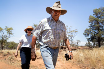 Uncle Peter Harris and NSW Premier Gladys Berejiklian, walk through the Mount Grenfell Historic Site