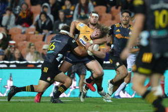 Bayley Kuenzle of the Brumbies is tackled during the round two Super Rugby Trans-Tasman match between the Chiefs and the ACT Brumbies at FMG Stadium.