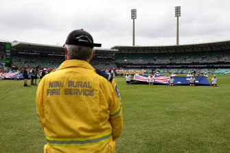 RFS volunteer Deputy Captain John Corry of the Ku-ring-gai Brigade looks on as a minute's applause is observed ahead of the New Year's Test.