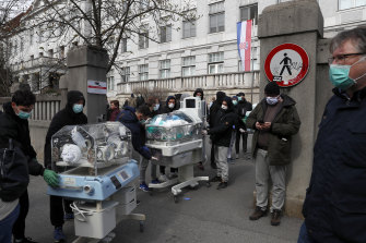 People carry incubators for newborn babies as the hospital is evacuated after the earthquake in Zagreb, Croatia, on Sunday.