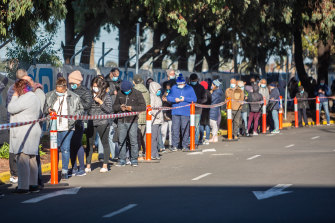 People line up at the vaccination hub at Sunshine Hospital on Sunday morning.