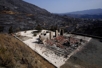 A burnt house is seen on outskirts of Ora village, in the background is the Larnaca mountain region, Cyprus, on Sunday.