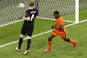 Denzel Dumfries celebrates the Netherlands' second goal in Amsterdam.
