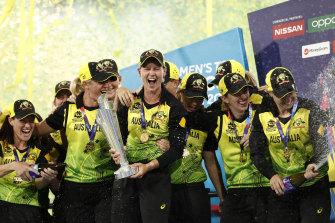 The Australian team celebrate their win over India on Sunday night.