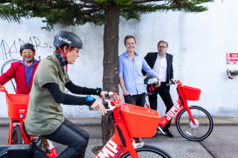 From left: Port Phillip councillor Dick Gross, Yarra mayor Jackie Fristacky  JUMP by Uber general manager Henry Greenacre and Melbourne councillor Nicholas Frances Gilley test out the new bikes on Tuesday.