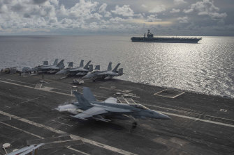 US aircraft carriers the USS Ronald Reagan and the USS Nimitz on patrol in the South China Sea last year.