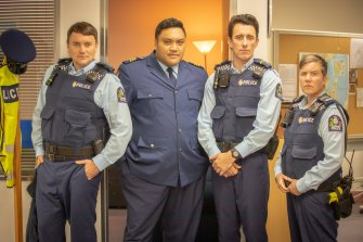 Constable Parker (Thomas Sainsbury), Sergeant Maaka (Maaka Pohatu) and officers Minogue (Mike Minogue) and O'Leary (Karen O'Leary) in Wellington Paranormal.