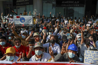 Demonstrators flash a three-finger salute, a symbol of resistance, during a protest in Yangon, Myanmar, on Wednesday.