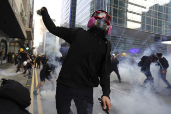 A protester hurls an object as police and demonstrators clash during a protest in Hong Kong on Saturday.