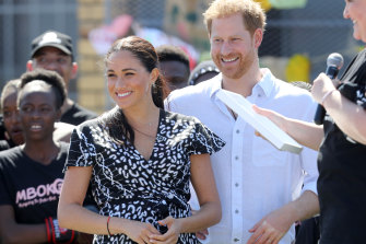 Meghan, Duchess of Sussex, and Prince Harry, Duke of Sussex, visit a Justice Desk initiative in Nyanga township during their royal tour of South Africa.
