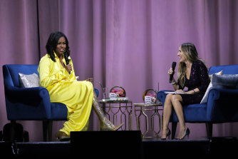 Former first lady Michelle Obama (left) is interviewed by Sarah Jessica Parker.