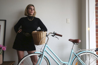 Lily Richardson at home in Clovelly with her beloved bicycle.