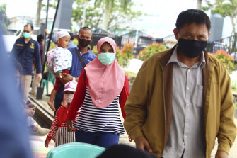 Family members of passengers on Sriwijaya Air SJY-182 arrive to give their relatives' data to the authorities for identification purposes, at Soepadio International Airport in Pontianak, Indonesia.