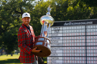 Berger with the plaid jacket and trophy.