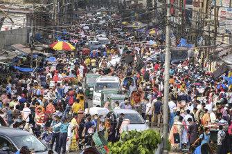 People shop at a market ahead of Eid-al Adha in Dhaka, Bangladesh.