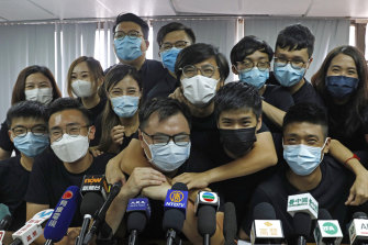 In this July 15, 2020, file photo, pro-democracy activists who were elected from unofficial pro-democracy primaries, including Joshua Wong, left, attend a press conference in Hong Kong.