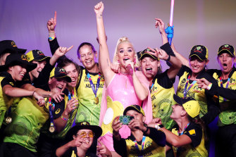 Katy Perry with the Australian team after the women's World T20 World Cup final at the MCG in March.