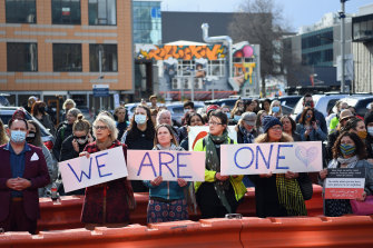 New Zealanders outside the Christchurch High Court show their support to the families of the dead and to survivors during the sentencing of Brenton Tarrant.