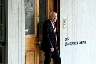 Former prime minister John Howard leaves the Australian Club.