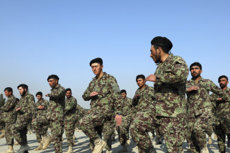 Newly graduated Afghan National Army soldiers march at their graduation ceremony.